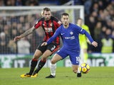 Steve Cook and Eden Hazard in action during the Premier League game between Chelsea and Bournemouth on January 31, 2018