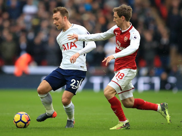 Christian Eriksen and Nacho Monreal in action during the Premier League game between Tottenham Hotspur and Arsenal on February 10, 2018