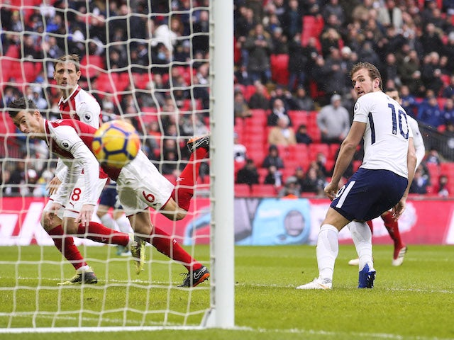 Harry Kane scores the opener during the Premier League game between Tottenham Hotspur and Arsenal on February 10, 2018