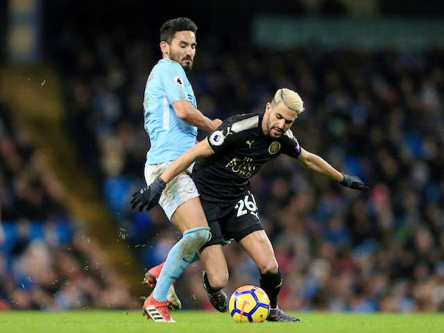 Ilkay Gundogan tussles with Riyad Mahrez during the Premier League game between Manchester City and Leicester City on February 10, 2018