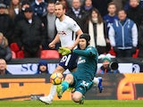 Petr Cech keeps out Harry Kane during the Premier League game between Tottenham Hotspur and Arsenal on February 10, 2018
