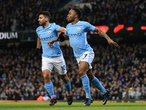 Raheem Sterling celebrates with Sergio Aguero after scoring during the Premier League game between Manchester City and Leicester City on February 10, 2018