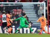 Roberto Firmino scores the opener during the Premier League game between Southampton and Liverpool on February 11, 2018