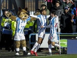Steve Mounie celebrates getting the Terriers' second during the Premier League game between Huddersfield Town and Bournemouth on February 11, 2018