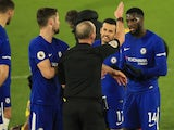 Referee Mike Dean sends off Tiemoue Bakayoko of Chelsea in the game against Watford on February 5, 2018
