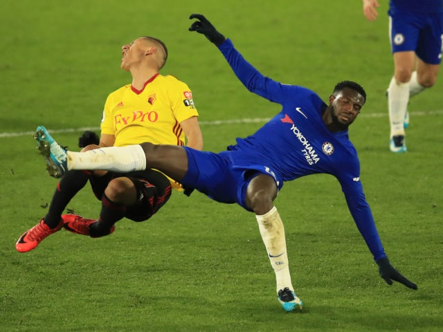 Tiemoue Bakayoko of Chelsea is shown a second yellow card for this foul on Richarlison of Watford on February 5, 2018