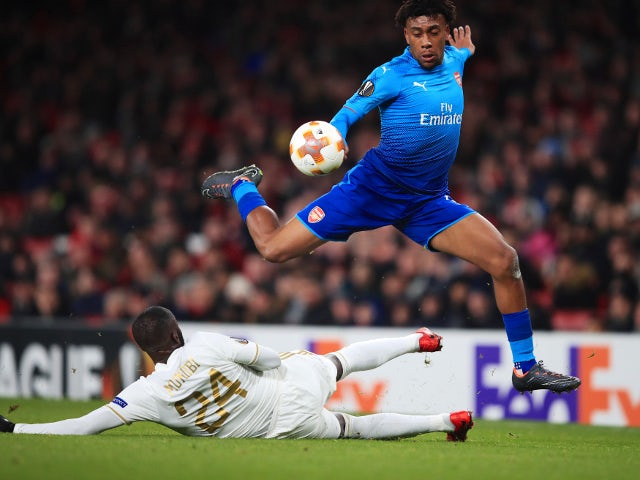 Alex Iwobi of Arsenal in action with Ronald Mukiibi of Ostersunds FK in the Europa League on February 22, 2018