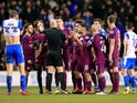 City players argue with Anthony Taylor after Fabian Delph is sent off during the FA Cup game between Wigan Athletic and Manchester City on February 19, 2018