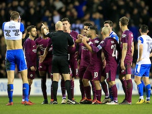 FA charges Wigan, Manchester City