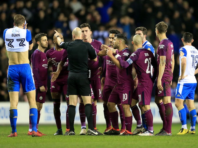 Wigan fined for pitch invasion against Man City