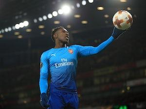 Arsenal survive scare to progress through