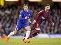 Eden Hazard and Gerard Pique in action during the Champions League group game between Chelsea and Barcelona on February 20, 2018