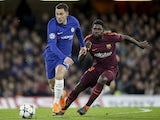 Eden Hazard and Samuel Umtiti in action during the Champions League group game between Chelsea and Barcelona on February 20, 2018