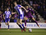 Ilkay Gundogan and Dan Burn in action during the FA Cup game between Wigan Athletic and Manchester City on February 19, 2018