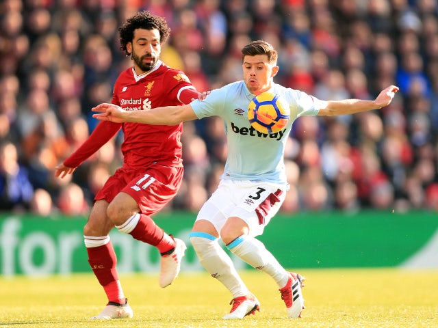 Mohamed Salah of Liverpool battles with Aaron Cresswell of West Ham United in the Premier League on February 24, 2018