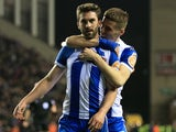 Will Grigg celebrates with Ryan Colclough after scoring during the FA Cup game between Wigan Athletic and Manchester City on February 19, 2018