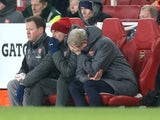 Arsene Wenger and his backroom staff in despair during the Premier League game between Arsenal and Manchester City on March 1, 2018