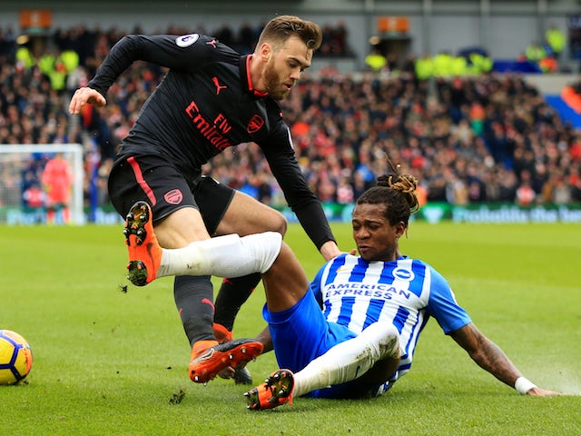 Calum Chambers and Gaetan Bong in action during the Premier League game between Brighton & Hove Albion and Arsenal on March 4, 2018