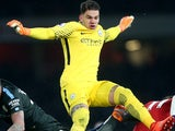 Ederson in action during the Premier League game between Arsenal and Manchester City on March 1, 2018