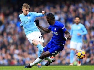 Kevin De Bruyne takes on Antonio Rudiger during the Premier League game between Manchester City and Chelsea on March 4, 2018