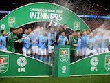 Manchester City players celebrate winning the EFL Cup on February 25, 2018