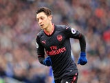 Mesut Ozil in action during the Premier League game between Brighton & Hove Albion and Arsenal on March 4, 2018