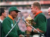 South Africa captain Francois Pienaar is given the William Webb Ellis Cup by president Nelson Mandela after winning the 1995 World Cup final