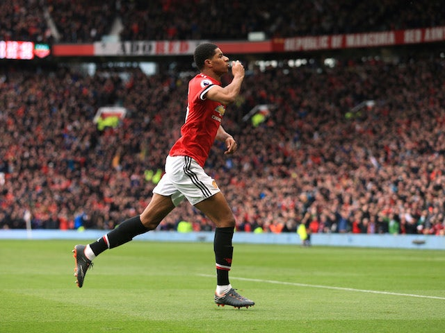 Marcus Rashford celbrates scoring the opener during the Premier League game between Manchester United and Liverpool on March 10, 2018