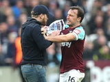 Mark Noble confronts a pitch invader during the Premier League game between West Ham United and Burnley on March 10, 2018