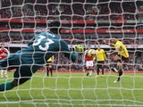 Petr Cech saves Troy Deeney's penalty during the Premier League game between Arsenal and Watford on March 11, 2018
