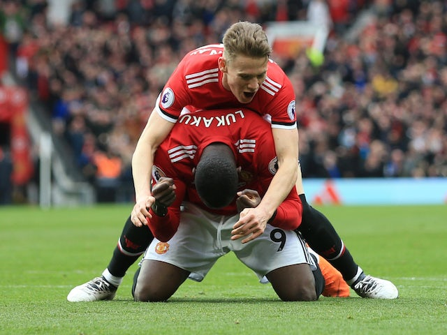 Scott McTominay and Romelu Lukaku in action during the Premier League game between Manchester United and Liverpool on March 10, 2018
