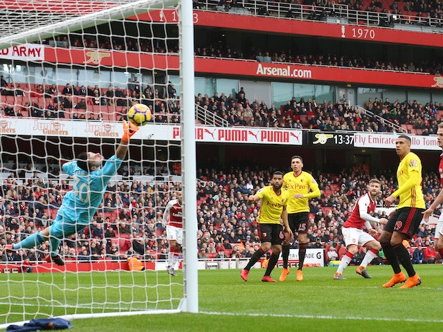 Shkodran Mustafi scores the opener during the Premier League game between Arsenal and Watford on March 11, 2018