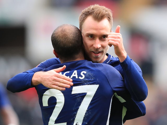 Christian Eriksen celebrates with Lucas Moura after scoring during the FA Cup quarter-final between Swansea City and Tottenham Hotspur on March 17, 2018