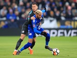 Eden Hazard grapples with Riyad Mahrez during the FA Cup quarter-final between Leicester City and Chelsea on March 18, 2018