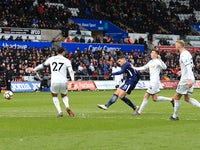 Erik Lamela scores the second during the FA Cup quarter-final between Swansea City and Tottenham Hotspur on March 17, 2018