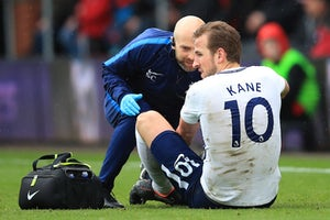Tottenham Hotspur striker Harry Kane sits injured during the Premier League game at Bournemouth on March 11, 2018