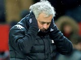 Jose Mourinho covers his ears during the FA Cup quarter-final between Manchester United and Brighton & Hove Albion on March 17, 2018