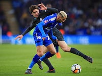Marcos Alonso and Riyad Mahrez in action during the FA Cup quarter-final between Leicester City and Chelsea on March 18, 2018
