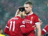 Mohamed Salah is embraced by Jordan Henderson during the Premier League game between Liverpool and Watford on March 17, 2018