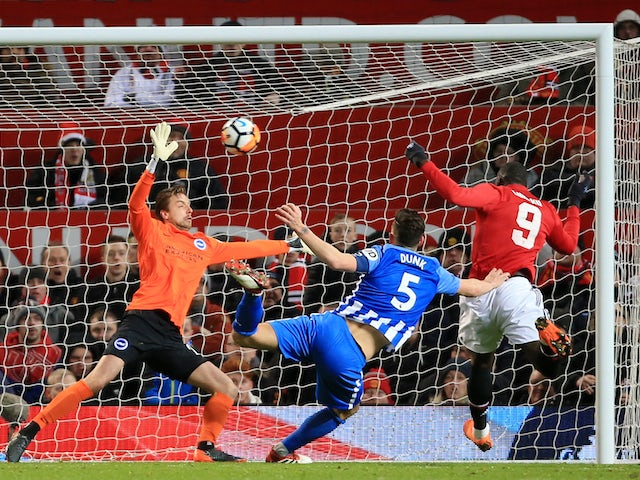 Romelu Lukaku scores the opener during the FA Cup quarter-final between Manchester United and Brighton & Hove Albion on March 17, 2018