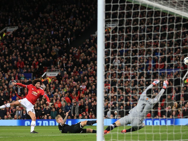 Sergio Rico saves a shot from Marouane Fellaini during the Champions League round-of-16 game between Manchester United and Sevilla on March 13, 2018