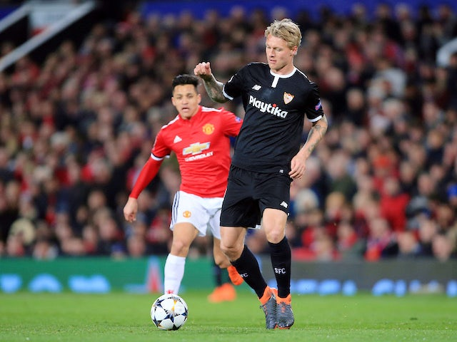 Simon Kjaer is pursued by Alexis Sanchez during the Champions League round-of-16 game between Manchester United and Sevilla on March 13, 2018