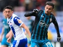Sofiane Boufal and Gary Roberts in action during the FA Cup quarter-final between Wigan Athletic and Southampton on March 18, 2018