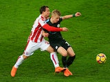 Xherdan Shaqiri and Oleksandr Zinchenko in action during the Premier League game between Stoke City and Manchester City on March 12, 2018