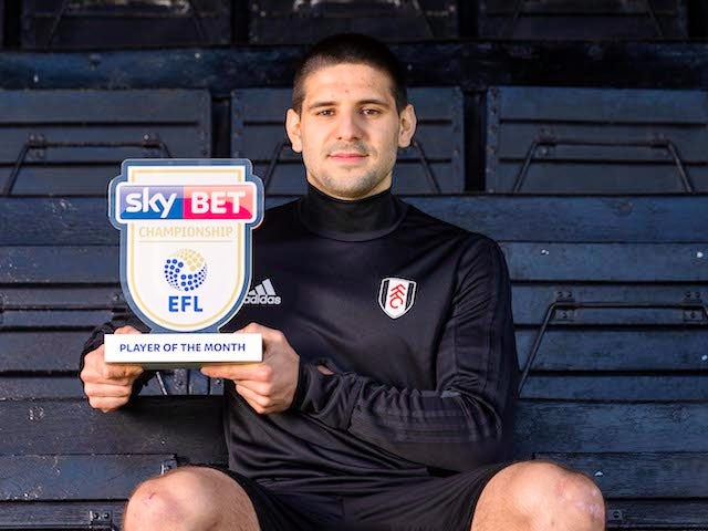 Fulham striker Aleksandar Mitrovic poses with his Championship player of the month award for March 2018