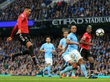 Manchester United's Chris Smalling scores against Manchester City on April 7, 2018
