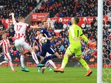Harry Kane scores for Tottenham Hotspur against Stoke City on April 7, 2018