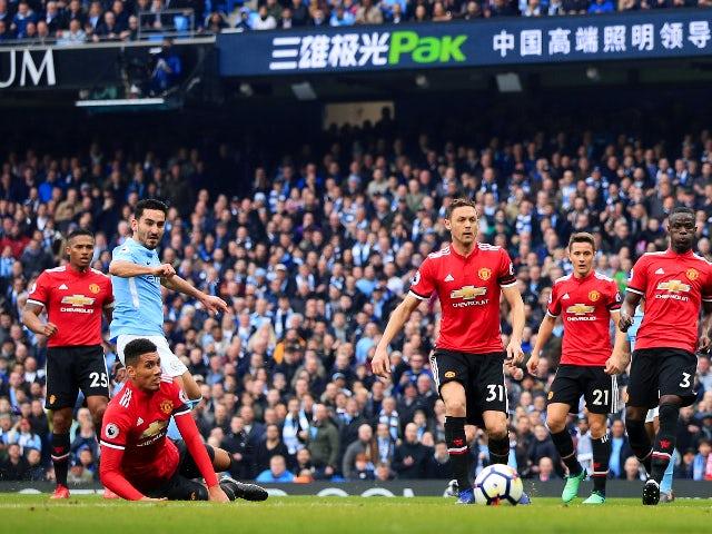 Ilkay Gundogan scores Manchester City's second goal against Manchester United on April 7, 2018