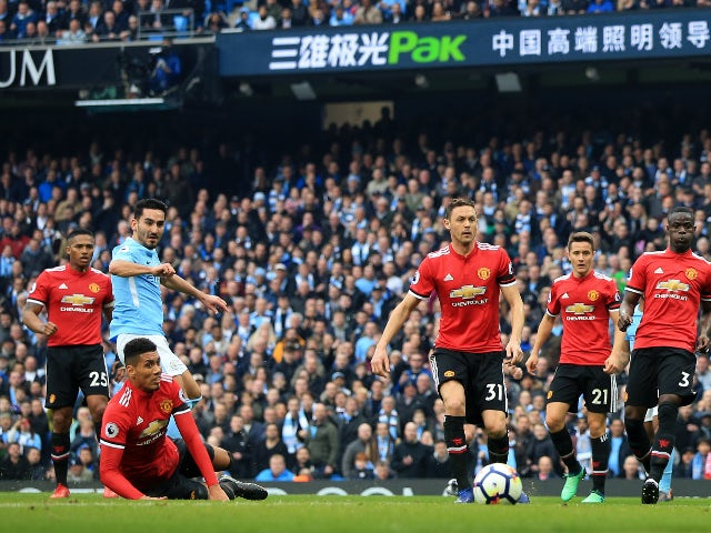 Ilkay Gundogan scores Manchester City's second goal against Manchester United on April 7, 2018