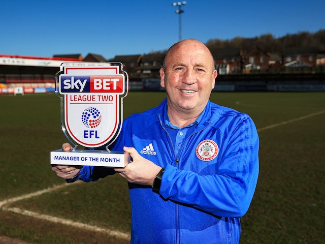 Accrington Stanley manager John Coleman poses with the League Two manager of the month award for March 2018